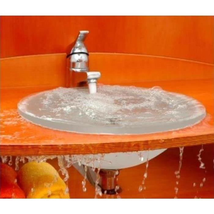 Orange wall and table with silver sink turned on and water overflowing.